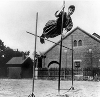Ina Gittings, University of Nebraska in 1906, is shown in the earliest photograph of a woman vaulting.